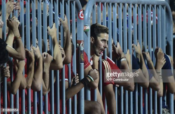 TOPSHOT Fans of Egypt's Al Ahly cheer on their team during their African Champions League group stage football match with Cameroon's Cotonsport at...