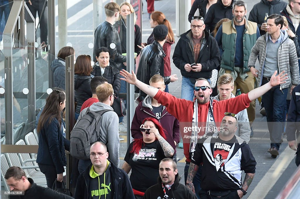 Fans of Eintracht Frankfurt are seen outside the central station Darmstadt prior to the Bundesliga Match of SV Darmstadt 98 and Eintracht Frankfurt at Merck-Stadion am Boellernfalltoron April 30, 2016 in Darmstadt, Germany. The city of Darmstadt ordered a ban on fans of Eintracht Frankfurt entering the city for 36 hours, which has now been overturned.