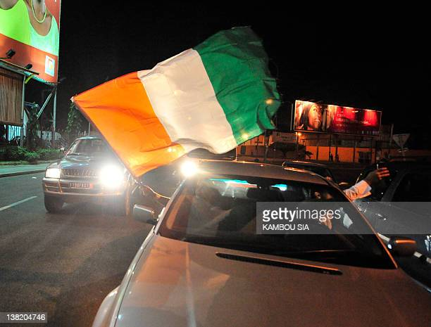 Fans of Elephants of Ivory Coast parade in their cars in the streets of Abidjan on February 4 2012 as they celebrate the qualification of their team...