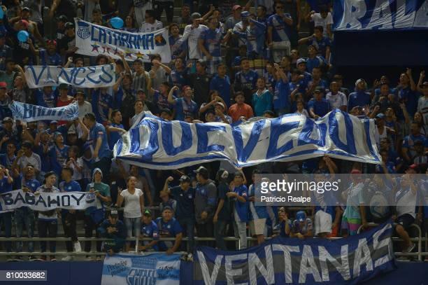 Fans of Emelec cheer during a first leg match between Emelec and San Lorenzo as part of round of 16 of Copa CONMEBOL Libertadores Bridgestone 2017 at...