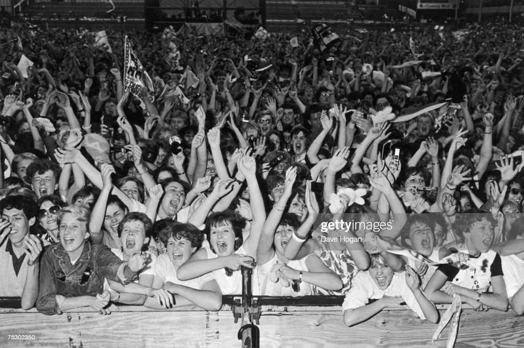 Fans of English new romantic pop group Duran Duran at one of the band's concerts, 1984.