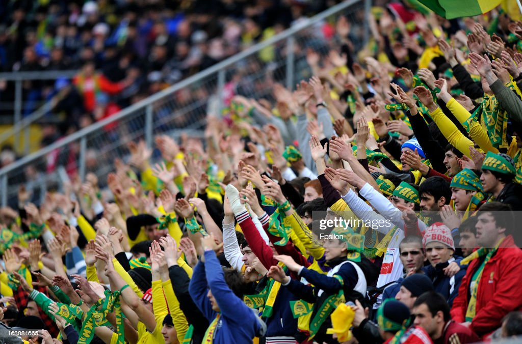 Fans of FC Anzhi Makhachkala during the Russian Premier League match between FC Anzhi Makhachkala and FC Krylia Sovetov Samara at the Anzhi Arena Stadium on March 17, 2013 in Kaspiysk, Russia.