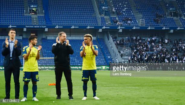 Fans of FC Copenhagen a watched by the police while Joel Kabongo Besar Halimi Alexander Zorniger head coach and Hany Mukhtar of Brondby IF celebrate...