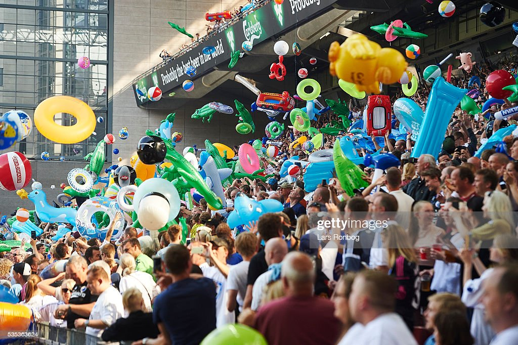 Fans of FC Copenhagen celebrate the Danish Championship and the summer with beach mattress, beach toys and swimming rings thrown in to the air after 13 minutes of the game during the Danish Alka Superliga match between FC Copenhagen and AGF Aarhus at Telia Parken Stadium on May 29, 2016 in Copenhagen, Denmark.