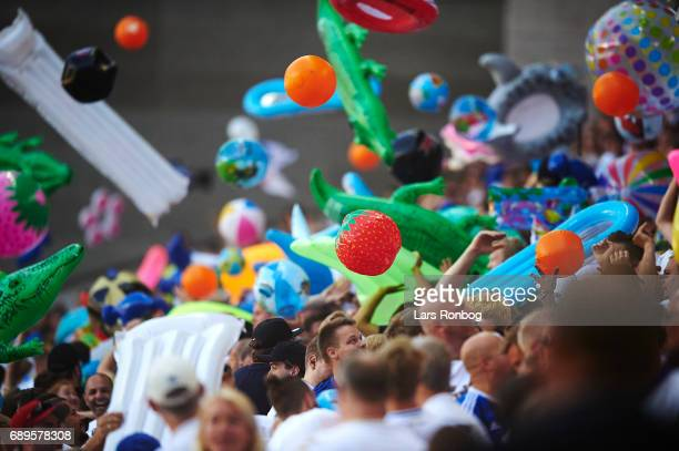 Fans of FC Copenhagen cheer with beach toys during the Danish Alka Superliga match between FC Copenhagen and Sonderjyske at Telia Parken Stadium on...