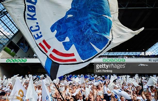 Fans of FC Copenhagen cheer with flags during the Danish Alka Superliga match between FC Copenhagen and Sonderjyske at Telia Parken Stadium on May 28...