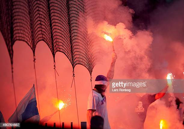 Fans of FC Copenhagen cheer with pyrotechnics during the Danish Alka Superliga match between Brondby IF and FC Copenhagen at Brondby Stadion on...