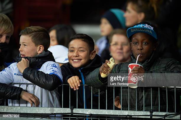 Fans of FC Copenhagen eating drinking and smiling during halftime in the Danish Superliga match between FC Copenhagen and Sonderjyske at Telia Parken...