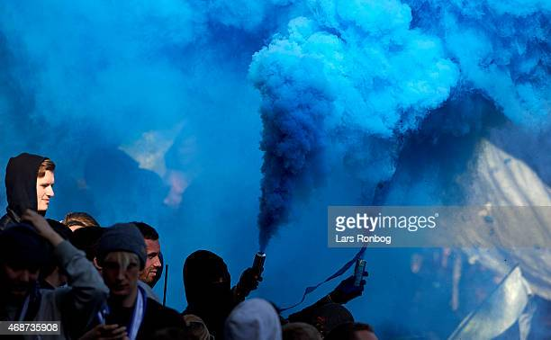 Fans of FC Copenhagen with pyrotechnics during the Danish Alka Superliga match between Brondby IF and FC Copenhagen at Brondby Stadion on April 6...