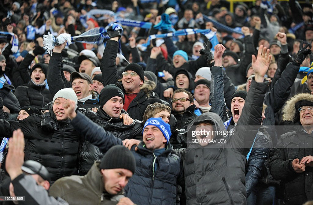 Fans of FC Dnipro react during UEFA Europa League, Round 32, football match of FC Dnipro against Basel in Dnipropetrovsk on February 21, 2013. AFP PHOTO/ GENYA SAVILOV