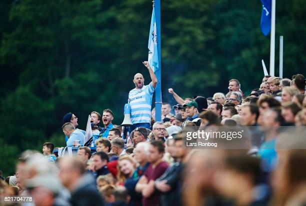 Fans of FC Helsingor cheer during the Danish Alka Superliga match between FC Helsingor and OB Odense at Helsingor Stadion on July 24 2017 in...