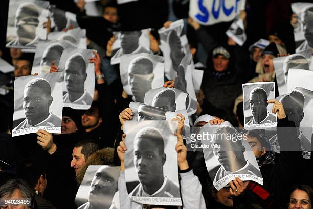 Fans of FC Internazionale Milano hold up posters of Mario Balotelli in response to racist abuse that the player received during last season's fixture...