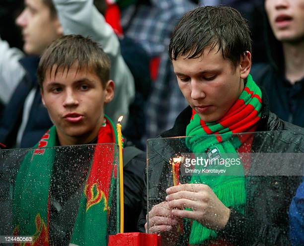 Fans of FC Lokomotiv Moscow light candles as they pay their respects to the victims of a plane crash carrying Russian hockey team Lokomotiv Yaroslavl...