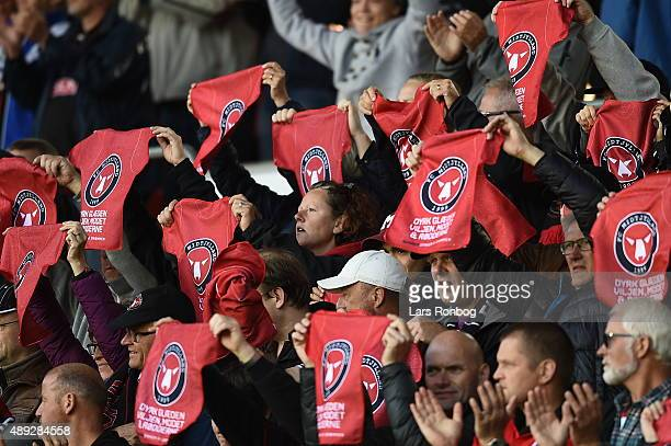 Fans of FC Midtjylland cheer and waving with scarf during the Danish Alka Superliga match between FC Midtjylland and FC Nordsjalland at MCH Arena on...