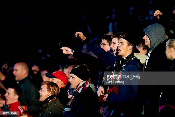Fans of FC Midtjylland cheer during the Danish Alka Superliga match between FC Midtjylland and OB Odense at MCH Arena on July 31 2015 in Herning...
