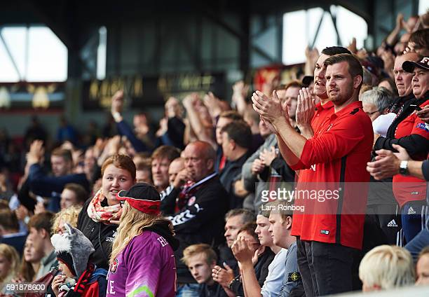Fans of FC Midtjylland cheer during the UEFA Europa League playoff 1st leg match between FC Midtjylland and Osmanlispor FK at MCH Arena on August 18...