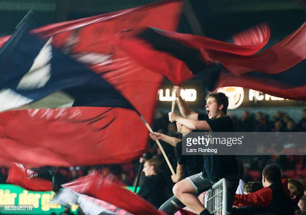 Fans of FC Midtjylland cheer with flags during the Danish Alka Superliga match between FC Midtjylland and AC Horsens at MCH Arena on October 20 2017...