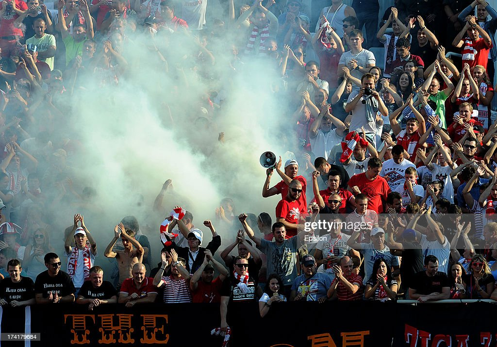 Fans of FC Spartak Moscow during the Russian Premier League match betweenn FC Ural Sverdlovsk Oblast and FC Spartak Moscow at the Tcentralny Stadium on July 21, 2013 in Ekaterinburg, Russia.