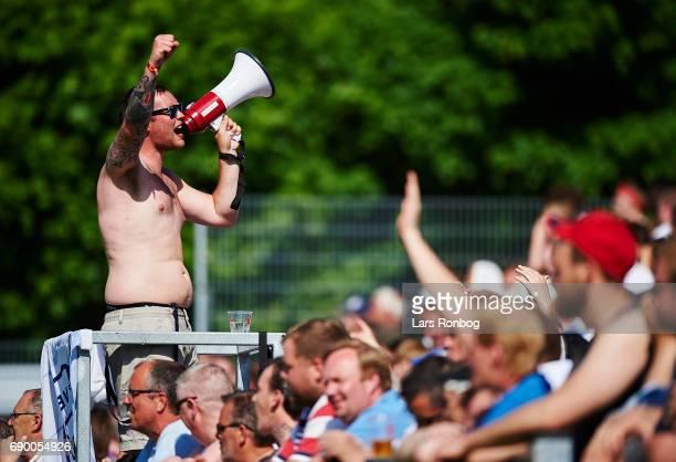 Fans of FC Vendsyssel cheer during the Danish NordicBet LIGA 1 division match between Hobro IK and FC Vendsyssel at DS Arena on May 27 2017 in Hobro...