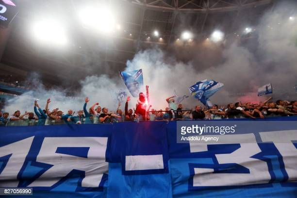 Fans of FC Zenit SaintPetersburg celebrate after their team scored a goal during the Russian Premiere League match between Zenit StPetersburg and FC...