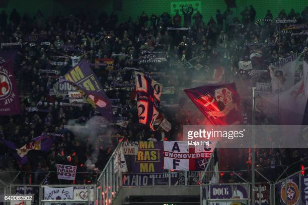 Fans of Fiorentina battle using fireworks during the UEFA Europa League Round of 32 first leg match between Borussia Moenchengladbach and ACF...