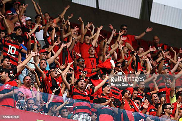 Fans of Flamengo cheer before a match between Sport Recife and Flamengo as part of Brasileirao Series A 2014 at Arena Pernambuco on November 9 2014...