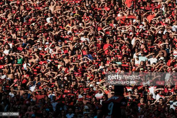 Fans of Fluminense cheer during their Copa Carioca final football match against Flamengo at Maracana stadium in Rio de Janeiro Brazil on May 7 2017 /...
