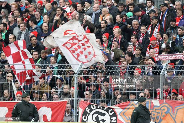 Fans of Fortuna Koeln the ball during the match between Viktoria Koeln and Fortuna Koeln at Sportpark Hoehenberg on November 24 2012 in Cologne...