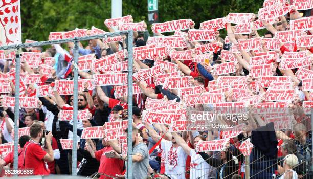 Fans of Fortuna support their team during the third league match between Fortuna Koeln and MSV Duisburg on May 13 2017 in Cologne Germany