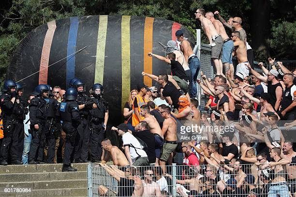 Fans of Frankfurt climb on the fence prior to the Bundesliga match between SV Darmstadt 98 and Eintracht Frankfurt at JonathanHeimesStadion am...
