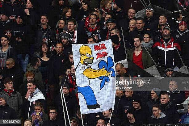 Fans of Frankfurt hold up a banner prior to the Bundesliga match between Eintracht Frankfurt and SV Darmstadt 98 at CommerzbankArena on December 6...