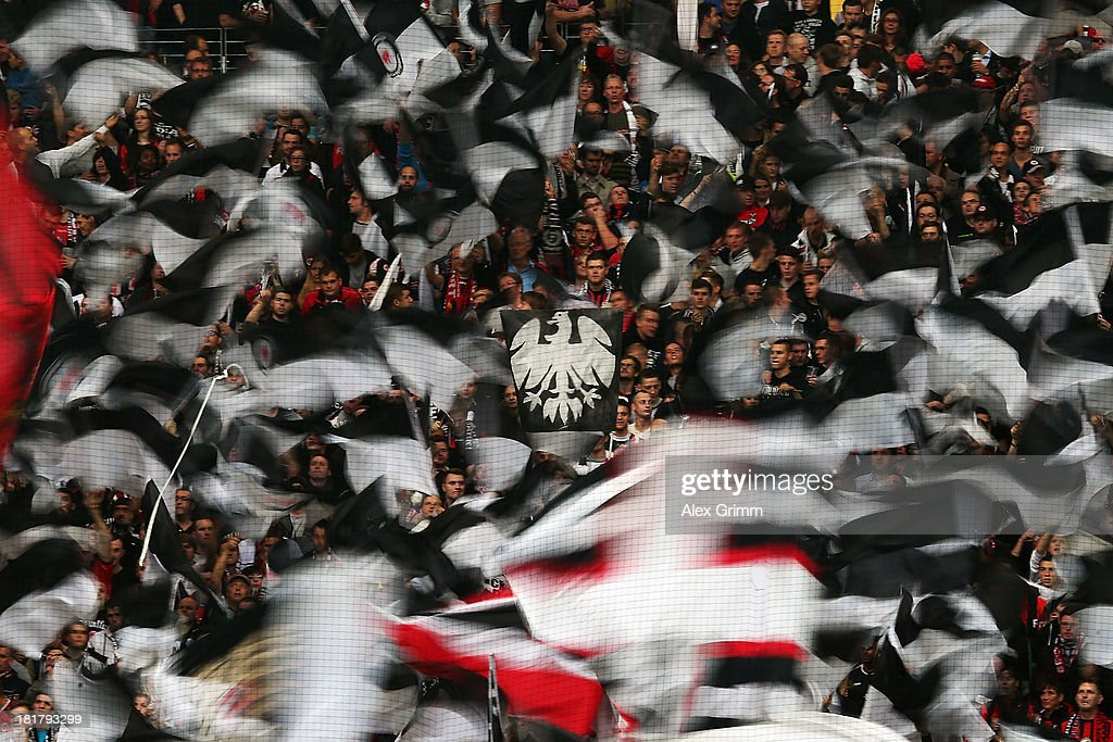 Fans of Frankfurt wave their flags prior to the DFB Cup second round match between Eintracht Frankfurt and VfL Bochum at Commerzbank-Arena on September 25, 2013 in Frankfurt am Main, Germany.