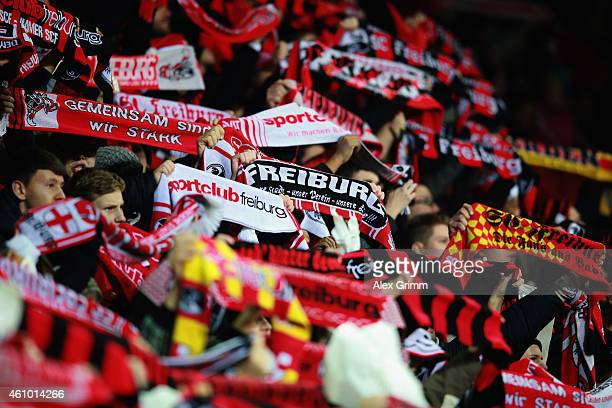 Fans of Freiburg hold up their scarfs prior to the Bundesliga match between SC Freiburg and Hannover 96 at SchwarzwaldStadion on December 21 2014 in...