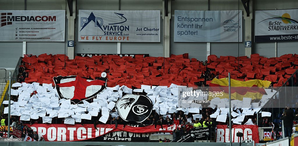 Fans of Freiburg support their team during the second Bundesliga match between SC Paderborn and SC Freiburg at the Benteler Arena on April 29, 2016 in Paderborn, North Rhine-Westphalia.