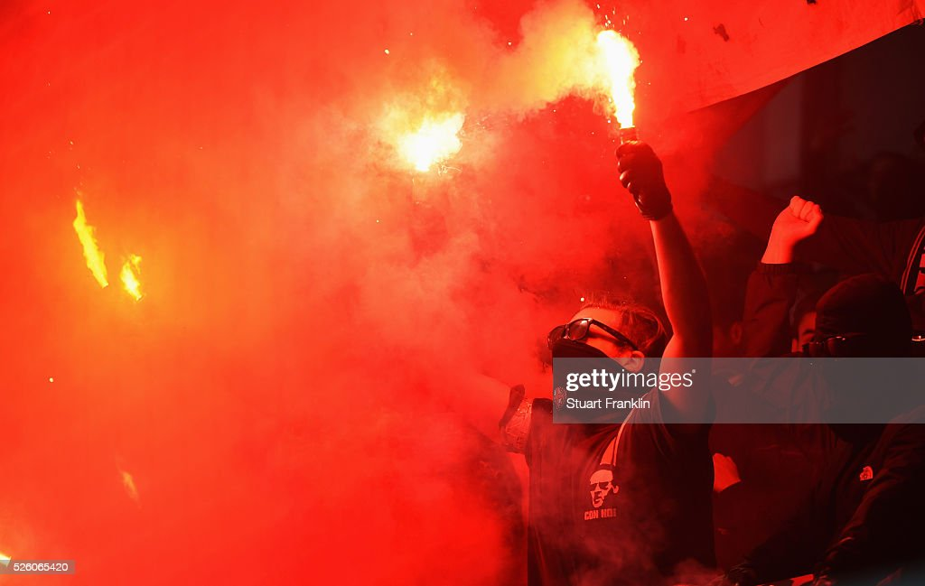 Fans of Freiburg use flares during the second Bundesliga match between SC Paderborn and SC Freiburg at the Benteler Arena on April 29, 2016 in Paderborn, North Rhine-Westphalia.