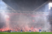 Fans of Genoa CFC fire up fireworks during the Serie A match between Genoa CFC and UC Sampdoria at Stadio Luigi Ferraris on January 5 2016 in Genoa...