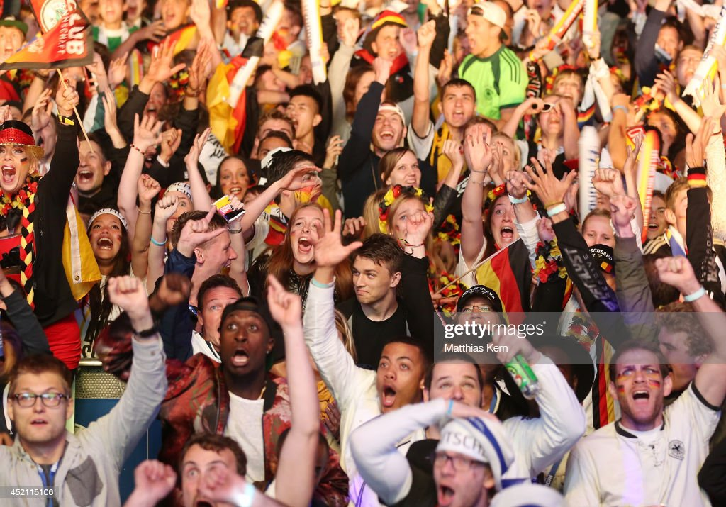 Fans of Germany celebrate after their team winning the 2014 FIFA World Cup final match between Germany and Argentina at the Fanmeile public viewing at Brandenburg Gate on July 13, 2014 in Berlin, Germany.