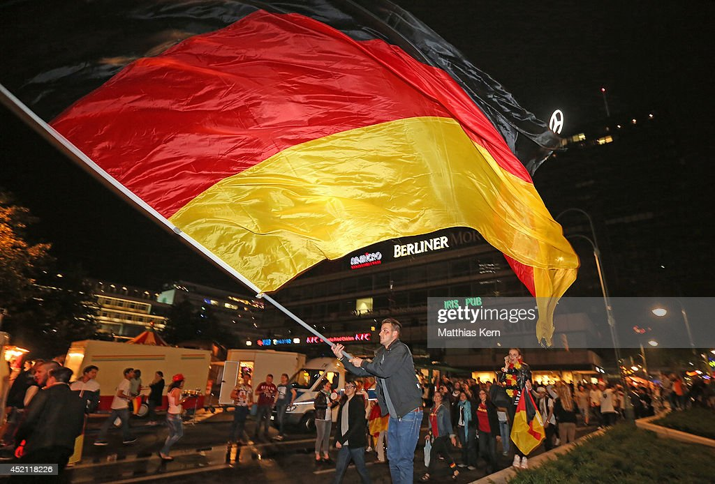 Fans of Germany celebrate at Kurfuerstendamm after their team winning the 2014 FIFA World Cup final match between Germany and Argentina on July 13, 2014 in Berlin, Germany.