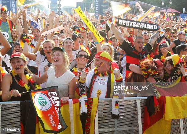 Fans of Germany celebrate during the 2014 FIFA World Cup Brazil quarter final match between Germany and France at the Fanmeile public viewing at...