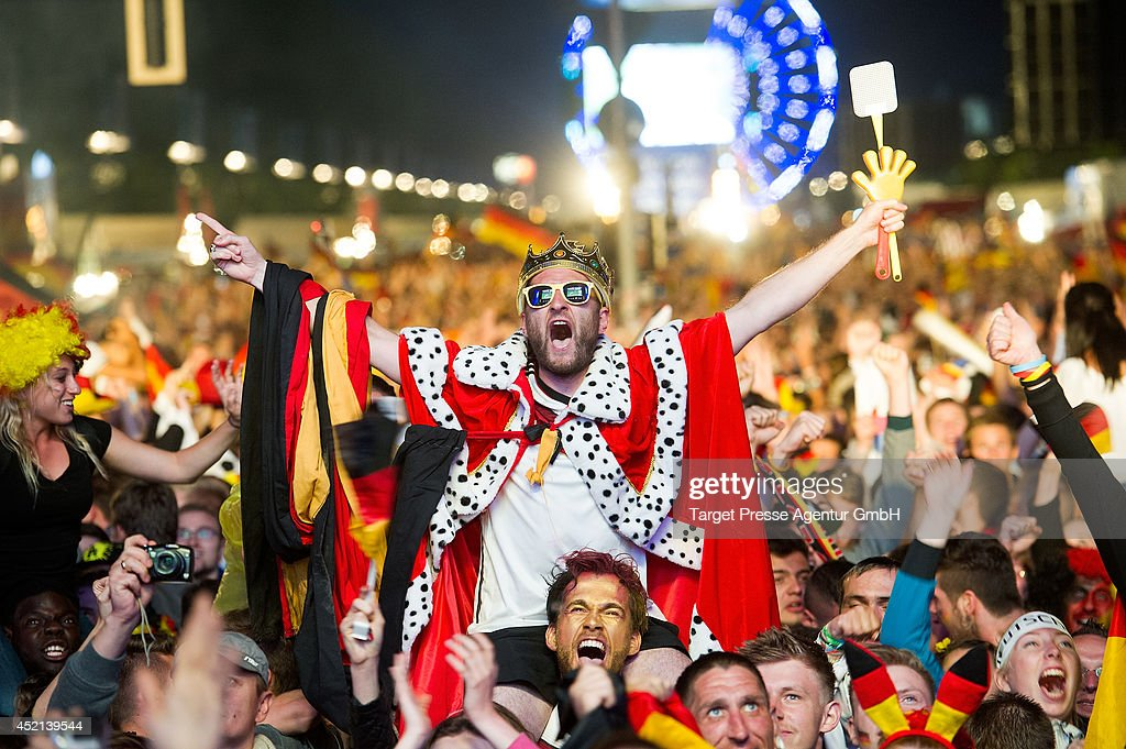 Fans of Germany cheer after Mario Goetze scored for Germany during the 2014 FIFA World Cup Final between Germany and Argentina at the Fanmeile public viewing at Brandenburg Gate on July 13, 2014 in Berlin, Germany.