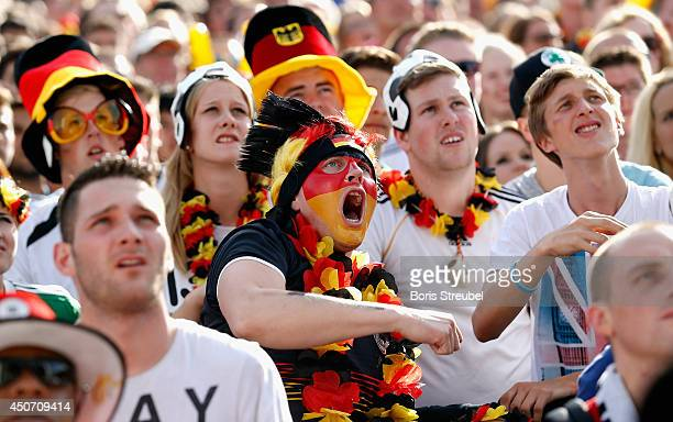 A fans of Germany reacts at the Fanmeile public viewing at Brandenburg Gate during the 2014 FIFA World Cup Brazil Group G match between Germany and...