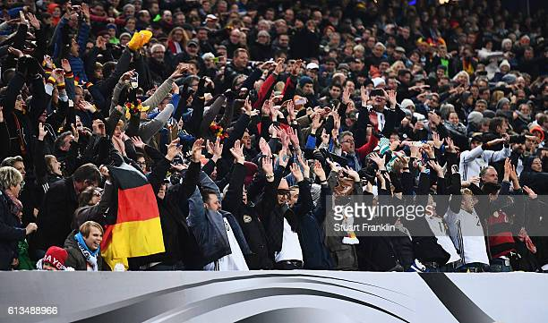 Fans of Germany watch during the 2018 FIFA World Cup Qualifier match between Germany and Czech Republic at Volksparkstadion on October 8 2016 in...