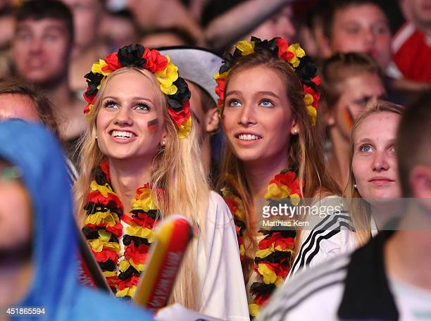 Fans of Germany watch the 2014 FIFA World Cup Brazil semi final match between Brazil and Germany at the Fanmeile public viewing at Brandenburg Gate...