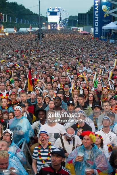 Fans of Germany watch the 2014 FIFA World Cup Final between Germany and Argentina at the Fanmeile public viewing at Brandenburg Gate on July 13 2014...