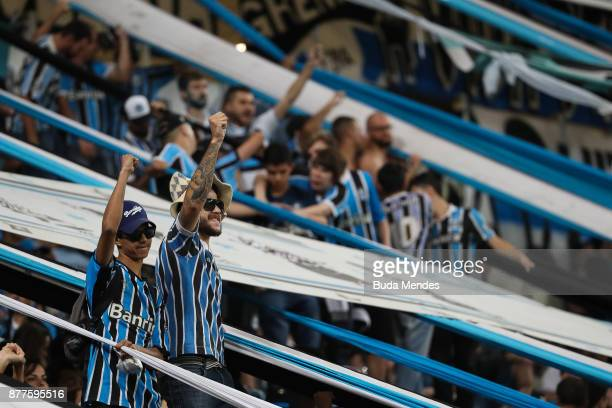 Fans of Gremio cheer before the first leg match between Gremio and Lanus as part of Copa Bridgestone Libertadores 2017 Final at Arena do Gremio on...