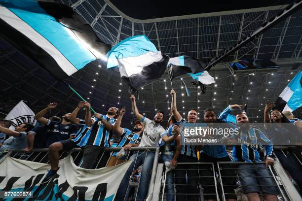 Fans of Gremio vibrate before the first leg match between Gremio and Lanus as part of Copa Bridgestone Libertadores 2017 Final at Arena do Gremio on...