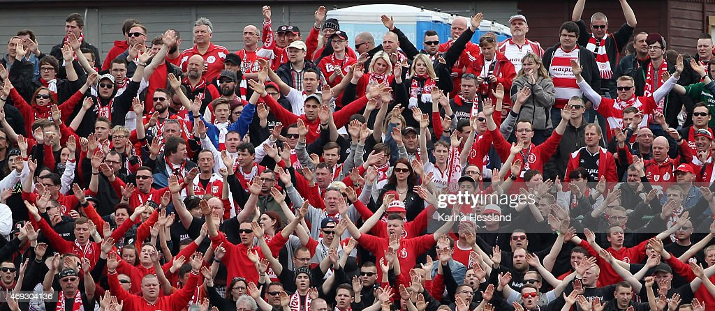 Fans of Halle celebrate the opening goal during the Third League match between FC Rot Weiss Erfurt and Hallescher FC at Steigerwaldstadion on April...