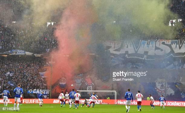Fans of Hamburg let off smoke flares during the Bundesliga match between Hamburger SV and SV Darmstadt 98 at Volksparkstadion on April 22 2017 in...