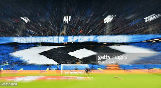 Fans of Hamburg make a banner in the form of the club logo during the Bundesliga match between Hamburger SV and Hertha BSC at Volksparkstadion on...