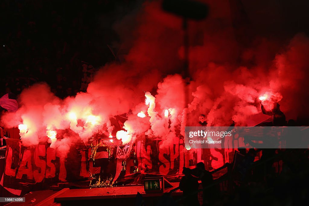 Fans of Hamburg throw smokebombs during the Bundesliga match between Fortuna Duesseldorf and Hamburger SV at Esprit-Arena on November 23, 2012 in Duesseldorf, Germany.
